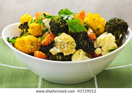 Vegetarian dish of fresh roasted organic vegetables - stock photo