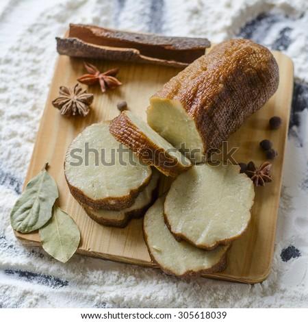 vegetarian dish sliced homemade seitan - stock photo