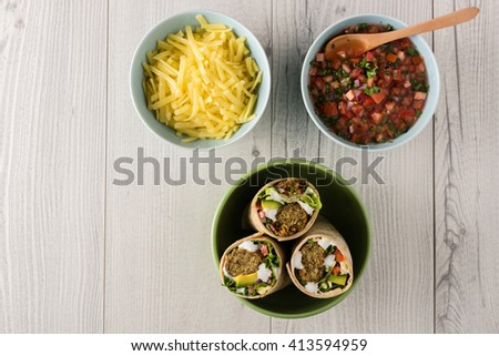 Vegetarian falafel wraps with avocado and cheese  - stock photo