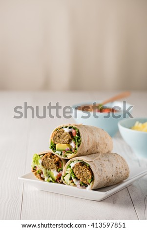 Vegetarian falafel wraps with avocado and cheese