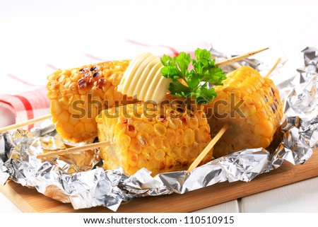 Vegetarian food - grilled Indian corn - stock photo
