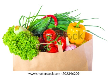 vegetarian food in a paper box on white background - stock photo