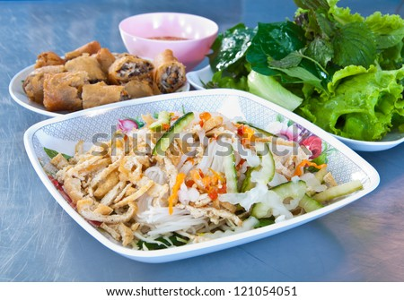 Vegetarian food in Thai style with fresh vegetable on table