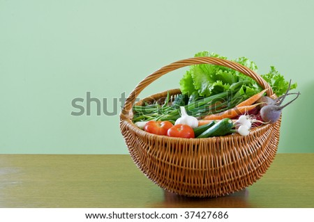 vegetarian food in vine basket - stock photo