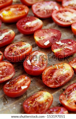 Vegetarian food. Sun dried tomatoes with herbs and garlic. Italian food vegetables - stock photo