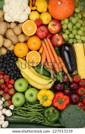 Vegetarian fruits and vegetables like apple, orange and tomato background - stock photo