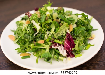 Vegetarian Green Salad Healthy Dinner With Lettuce, Arugula, Olives And Capers Served On A Plate
