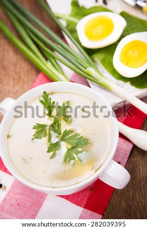 vegetarian green soup with a onion, eggs and bread
