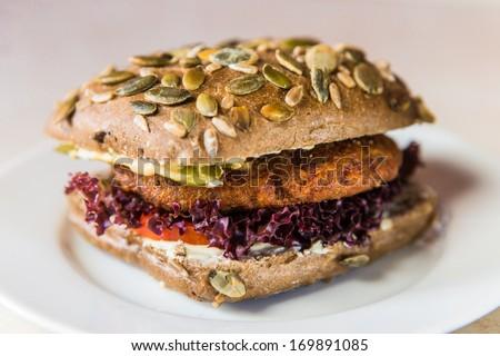 vegetarian hamburger with bun with pumpkin seeds - stock photo