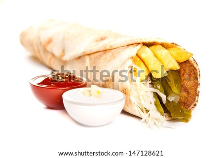Vegetarian kebab with fries and vegetables - stock photo