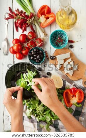Vegetarian low calorie Greek salad preparation top view  - stock photo