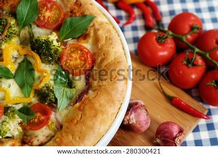 Vegetarian margarita pizza and vegetable background. - stock photo