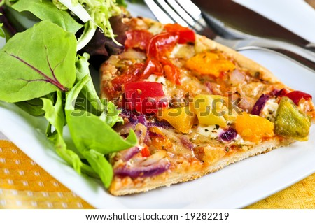 Vegetarian meal of vegetable pizza and green salad - stock photo