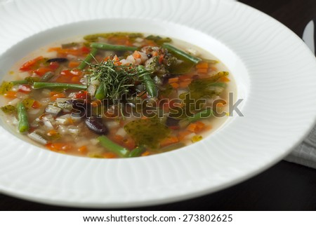 Vegetarian minestrone soup on a wooden table. Italian cuisine. - stock photo