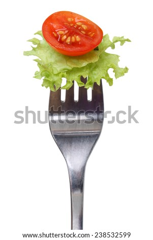 Vegetarian or vegan eating salad, lettuce and tomato on fork isolated on a white background - stock photo