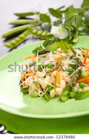 Vegetarian Pasta with asparagus, green pea, carrots, basil and Parmesan cheese.