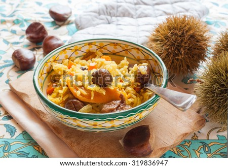 Vegetarian pilau rice with chestnuts, onions, carrots, dried apricots, figs and dates horizontal