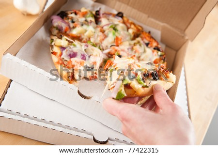 Vegetarian Pizza Loaded with Various Vegetables in Take Out Box - stock photo