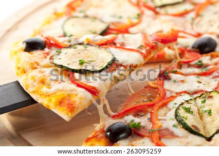 Vegetarian Pizza made from Mozzarella Cheese, Paprika, Tomatoes and Mushrooms - stock photo