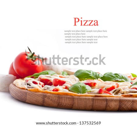 Vegetarian pizza with peppers, mushrooms, tomatoes, olives and basil - stock photo