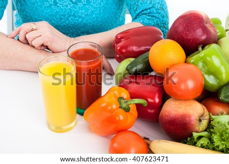 Vegetarian products: fruit, vegetables and fresh juice, isolated on white background - stock photo
