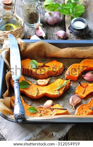 Vegetarian pumpkin baked with olive oil, rosemary, basil and garlic