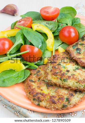 Vegetarian quinoa fritters with fresh salad - stock photo