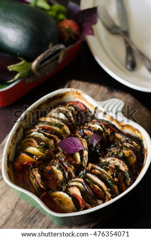 Vegetarian Ratatouille - traditional French Provencal vegetable dish cooked in oven.  Against the background of the main ingredients