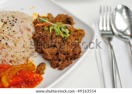 Vegetarian rendang chicken or mutton with unpolished red rice. Suitable for concepts such as diet and nutrition, healthy lifestyle, and food and beverage.