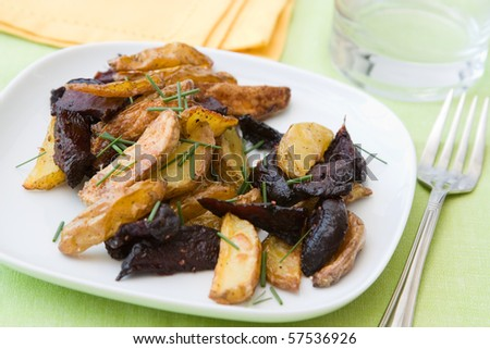 Vegetarian salad made from baked beetroot and potatoes.