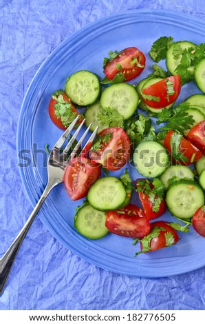 Vegetarian salad on a blue plate