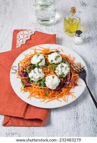 Vegetarian salad with carrot, red cabbage, parsley and cheese ball - stock photo