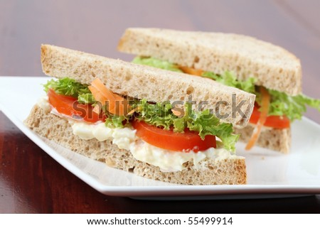 Vegetarian sandwiches with egg spread, lettuce, tomatoes and carrots - stock photo
