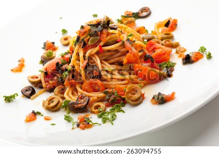 Vegetarian Spaghetti with Vegetables, Olives and Tomato Sauce - stock photo