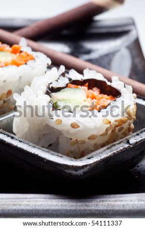 Vegetarian sushi California roll with rice and seaweed on Japanese plates - stock photo