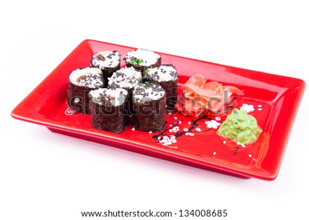 Vegetarian sushi roll served in a form of flower on a red plate isolated on white - stock photo