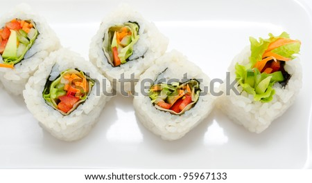 vegetarian sushi rolls with avocado and vegetables