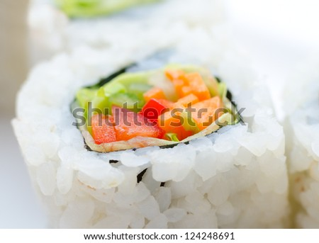 vegetarian sushi rolls with avocado and vegetables, macro - stock photo