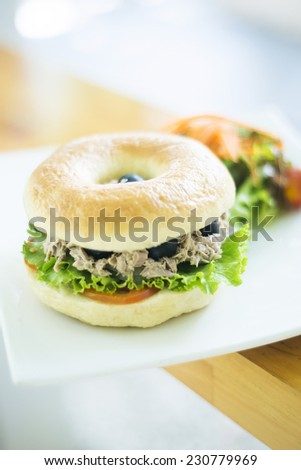 vegetarian tuna bagel with side salad