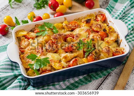 Vegetarian Vegetable casserole with zucchini, mushrooms and cherry tomatoes - stock photo