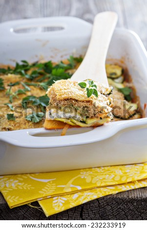 Vegetarian zucchini and ricotta bake with breadcrumbs and cheese - stock photo