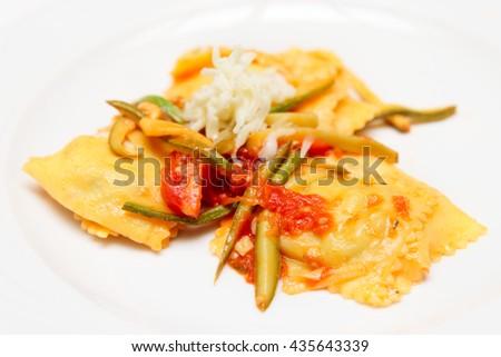 Vegetarian zucchini with tomatoes and zucchini slices - stock photo