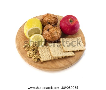 vegeterian food on cutting board with white background