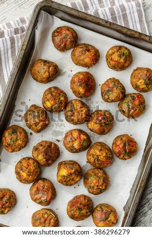 Veggie balls on cake pan - stock photo