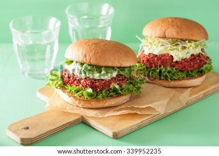 veggie beet and quinoa burger with avocado dressing - stock photo