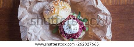 Veggie beet burger with garlic sauce - panorama - stock photo