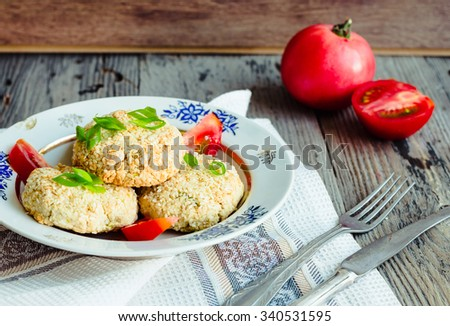 veggie burgers from beans and chickpeas with tomato and herbs, vegetarian dinner,selective focus - stock photo