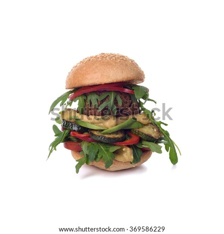 Veggie chickpea falafel burger with arugula, zucchini, avocado and mustard. Isolated on white, clipping path included. - stock photo
