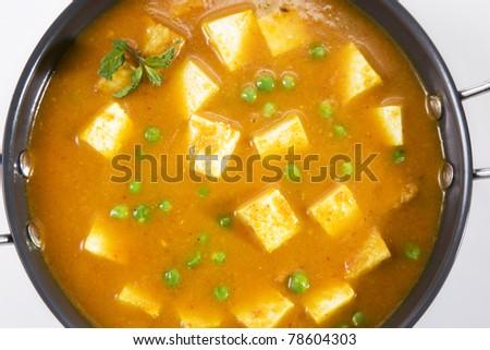 Veggie Delicious cottage cheese cooked with peas in a creamy sauce - stock photo