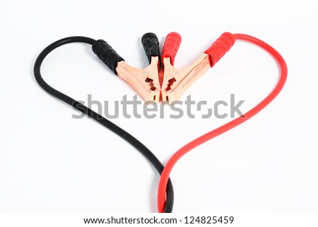 Vehicle battery extension cable in love on isolated white. - stock photo